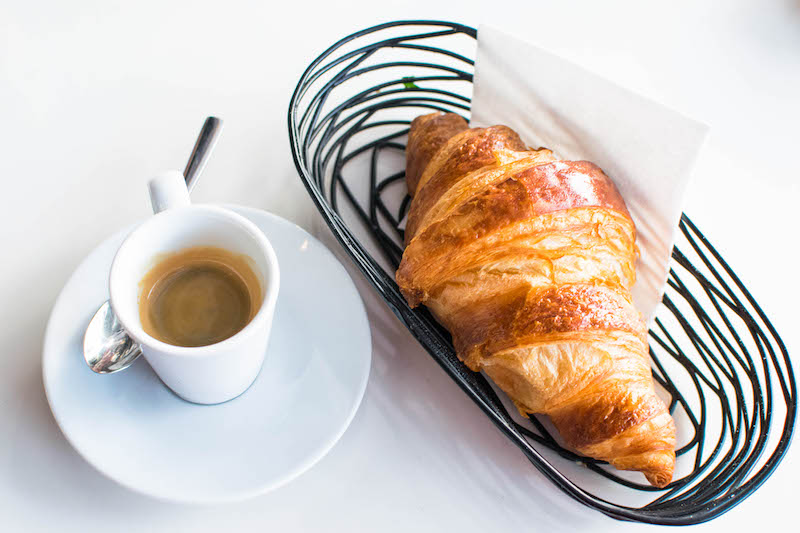 French breakfast at a French cafe, something that you must include on your Paris itinerary! #travel #food #croissant