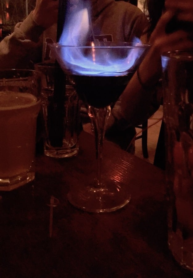 Drink on fire at Red Bar in Belgrade, Serbia. Read this guide to cocktails and beer in Belgrade with tips on where to find the best cocktails in Belgrade! #travel #cocktails #belgrade #serbia #balkans
