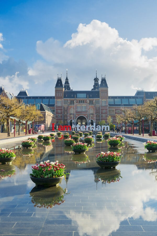 View of the Rijksmuseum, one of the best museums in Amsterdam to visit. Read tips for skipping the line at the Rijksmuseum and what museums in Amsterdam to visit! #travel #Amsterdam #holland #dutch #netherlands