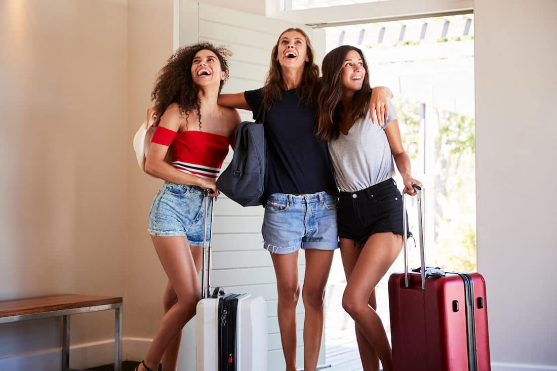 Image of woman greeting houseguest. Read tips on how to be a good houseguest with houseguest etiquette, houseguest horror stories, and what NOT to do as a houseguest. #travel