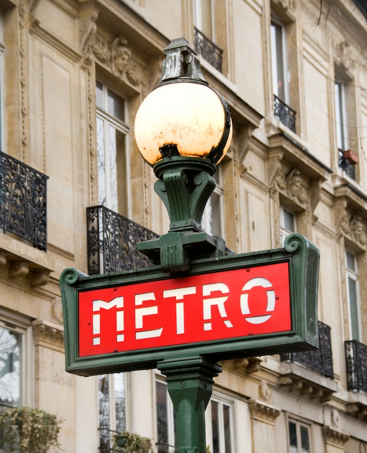 Typical Parisian Metro sign in Street Lamp. Paris France.