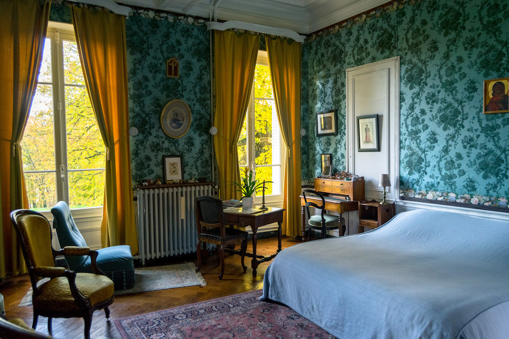Room at chateau in France with antique furniture. Read what it's like to stay at a castle in France with bucket list inspiration for staying in a chateau! #travel #france