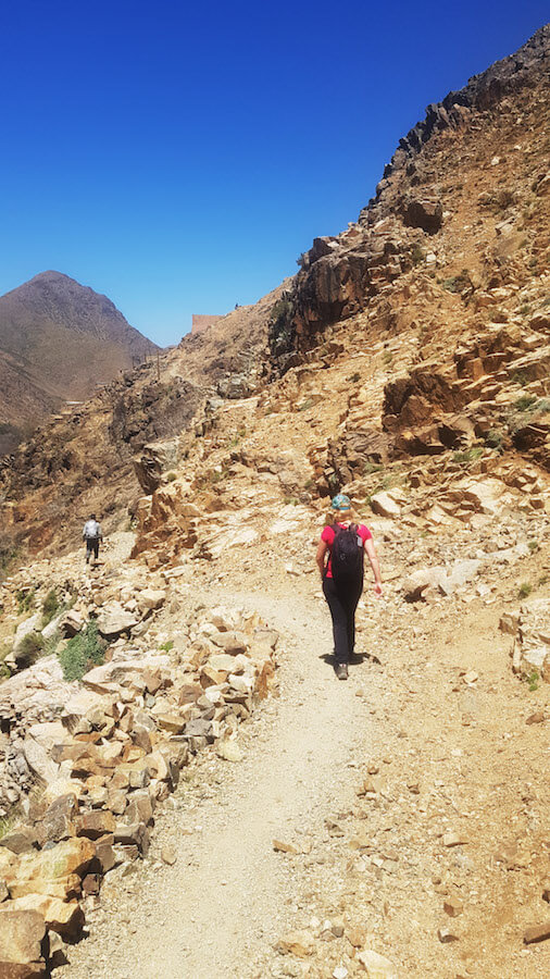 Girl hiking outside of Imlil, Morocco. This village in the High Atlas mountains is the perfect day trip from Marrakech. #travel #morocco #marrakech