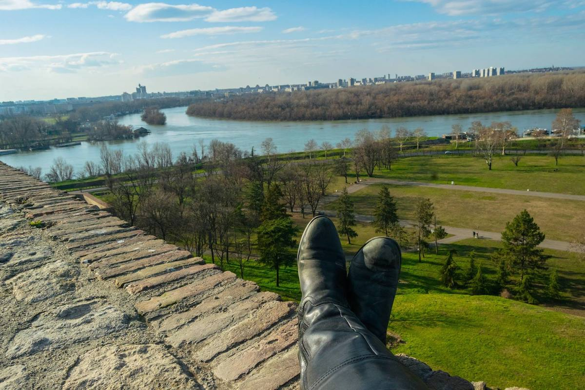 Solo female traveler putting her feet up near the fortress in Serbia. #travel #serbia
