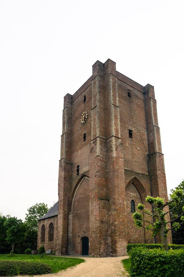 Church tower of Sint Anna ter Muiden, a historic Dutch town near Sluis and one of the most beautiful cities in Zeeland