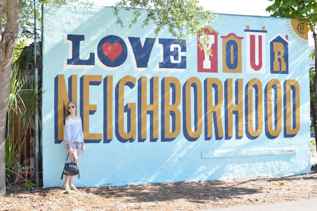 Love your Neighborhood mural in St. Pete, Florida. Exploring the artwork of St. Petersburg, Florida is one of the best things to do in St. Pete! #travel #florida #USA