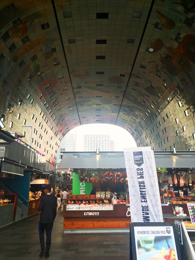 The Markthal, a food hall in Rotterdam the Netherlands. This beautiful piece of architecture is a must-see in Rotterdam! #travel #holland #rotterdam