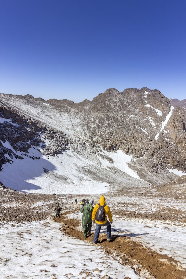 Hiking on Jebel Toubkal, Morroco's highest mountain. Read about the best place to go hiking in Morocco. #travel #adventuretravel #morocco #mountain