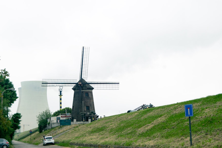 The historic windmill of Doel, Belgium. Read about the history of Doel, Belgium and what may happen to this abandoned town. #travel #doel #belgium #molen