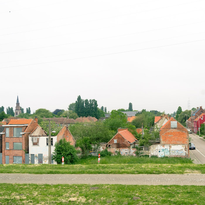 Photo of the Belgian ghost town of Doel, Belgium. Read what it's like to visit this semi-abandoned town in Belgium full of street art. #travel #belgium #abandonedplaces #doel