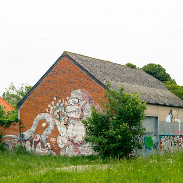 Street art on the buildings of Doel, Belgium. This Belgian ghost town is famous for its street art. #travel #streetart #belgium #doel