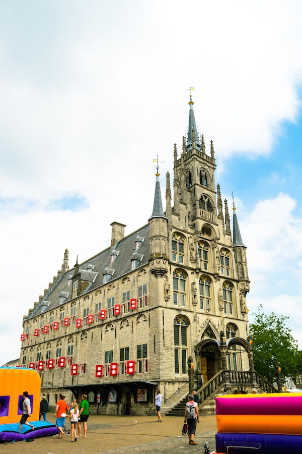 Gouda City Hall, one of the must-see attractions in Gouda, a day trip from Amsterdam. The Gouda Cheese Market happens in front of here every Thursday during the summer. #travel #gouda #netherlands #holland