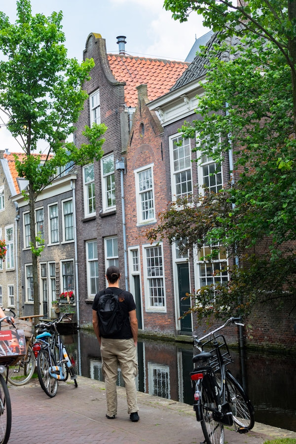 Man wearing a lightweight packable backpack during a day trip to Delft. Read our honest review of the Tortuga Setout packable daypack. #travel #packing