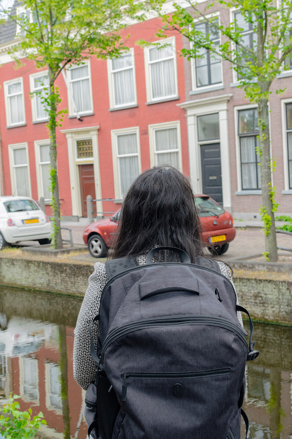 Woman wearing a lightweight travel backpack that is allowed on budget airlines. #travel #packing