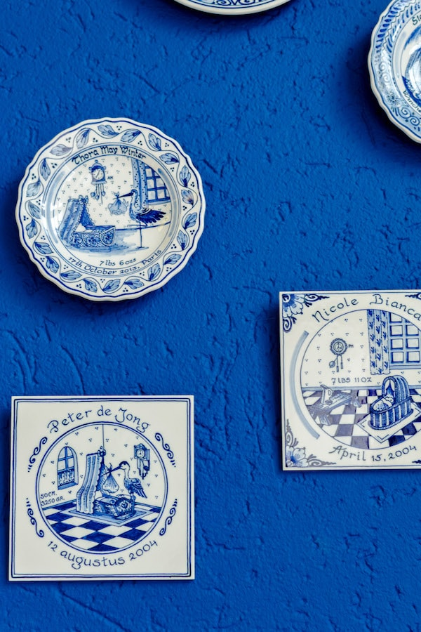 Delftware tiles on the wall at the Delft Blue Factory, De Delftse Pauw, one of the last remaining Delft pottery factories in the city of Delft. #travel #delft #holland #netherlands