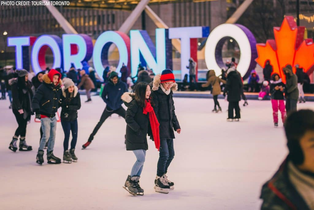 Couple iceskating in Toronto in winter. #toronto #canada #travel (Photo by Tourism Toronto)