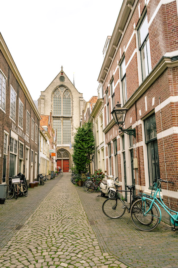 Pieterskerk in distance in the Pieterskwartier in Leiden. Read about the best things to do in Leiden, the Netherlands! #travel #Netherlands #holland #leiden