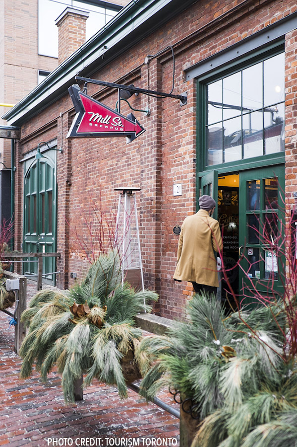 Man in the Distillery District in Toronto, Canada. This district has a lot of cool events in winter! #toronto #canada #travel (Photo by Tourism Toronto)