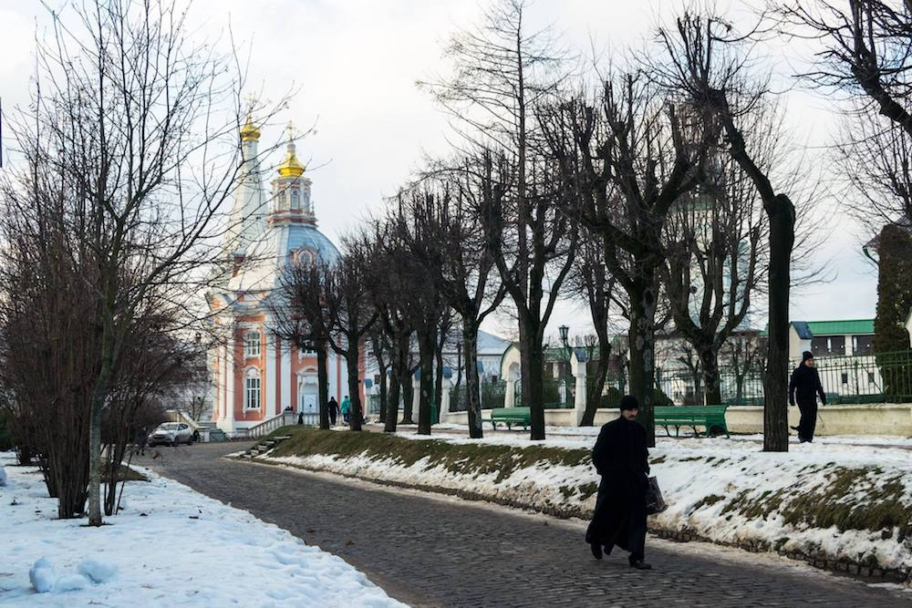 Monk walking around the grounds of Architectural Ensemble of the Trinity Sergius Lavra in Sergiev Posad, Russia. #Russia #Travel