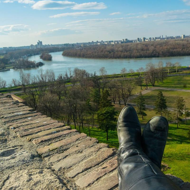Girl enjoying beautiful view from Belgrade Fortress Park, one of the best free attractions in Belgrade. #travel #belgrade #serbia