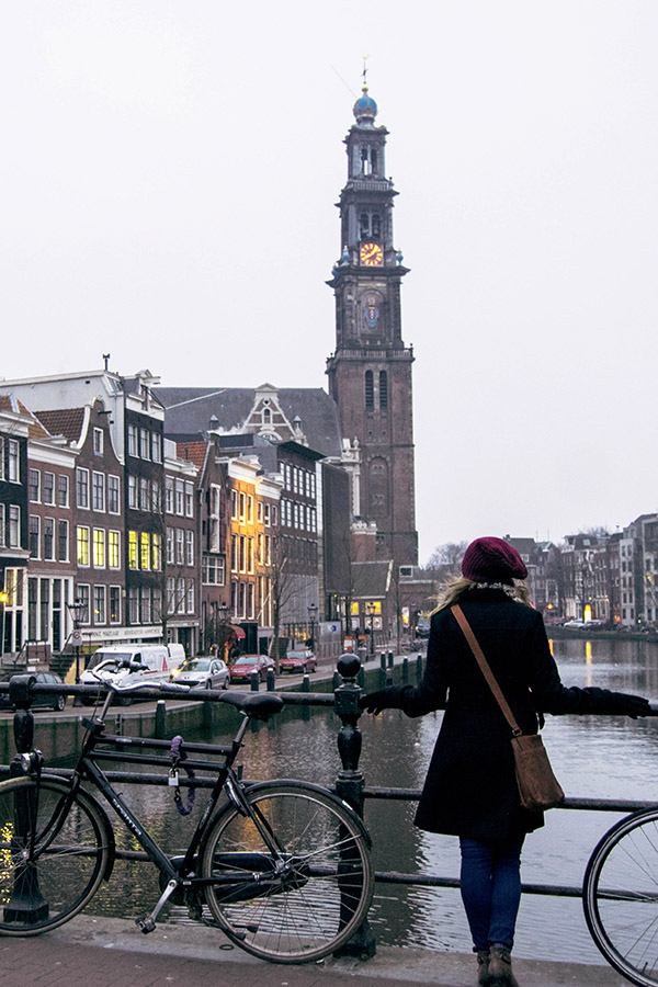 Girl admiring Amsterdam. Read about living in Amsterdam written by a former resident! #amsterdam #expat