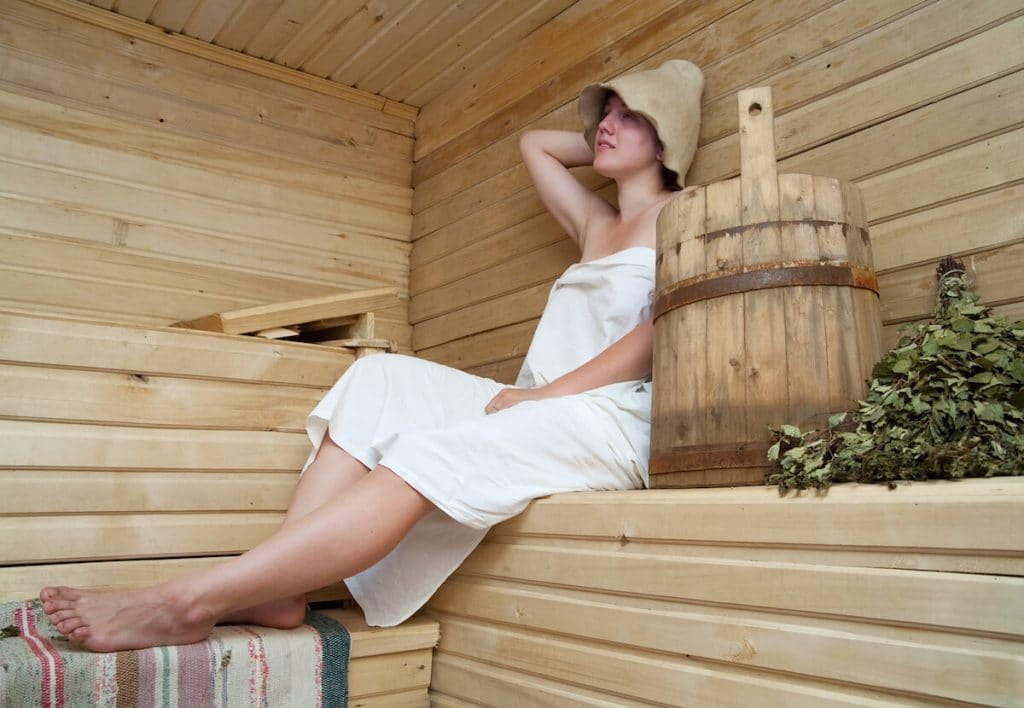 Girl enjoying a Russian bath experience. Read about why you should visit a Russian banya! #travel #russia