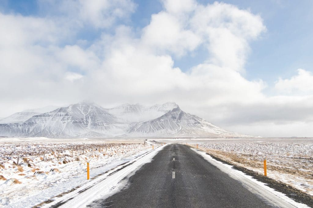 Snowy landscape surrounding a road in Iceland during the winter season. #iceland