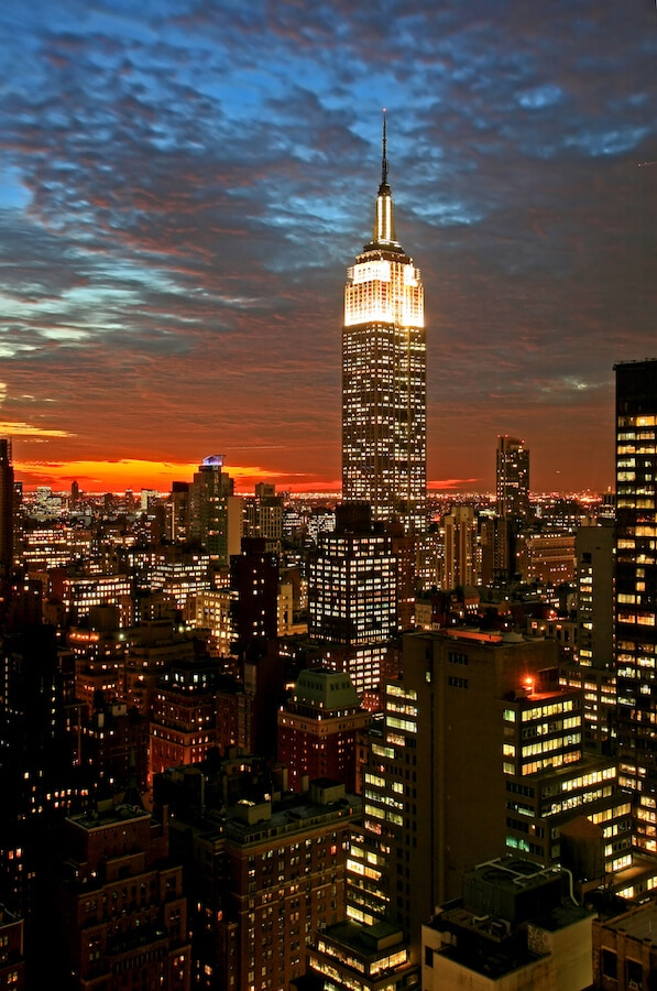 Don't miss seeing the Empire State Building lit up at night on your New York City itinerary! #NYC #NewYorkCIty #travel