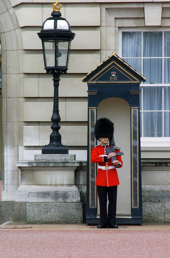 Guard outside of Buckingham Palace. Seeing the changing of the guards is one of the best things to do in London in one day! #travel #london