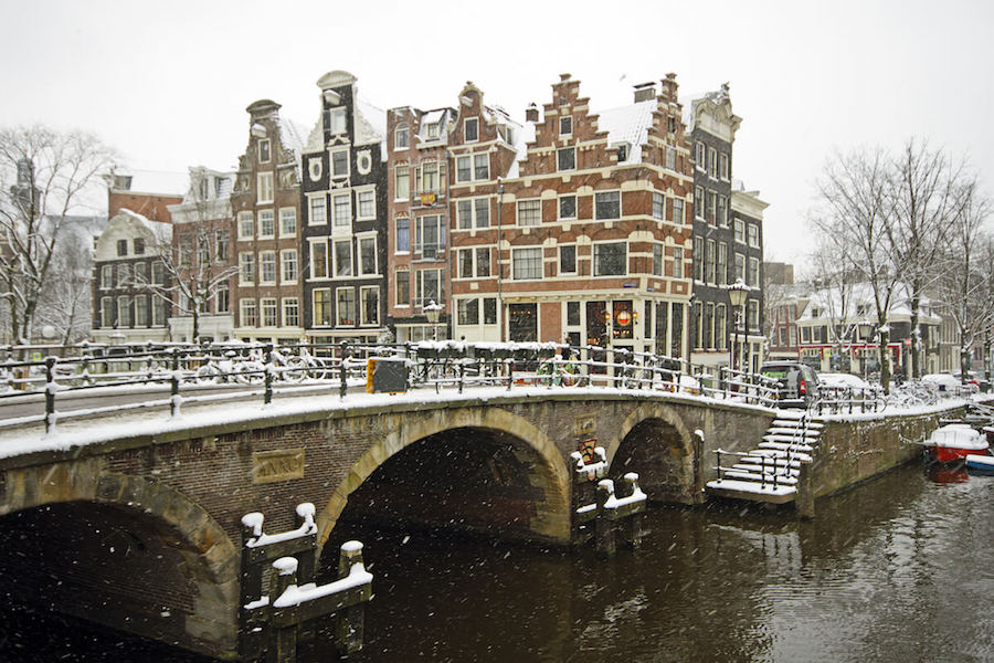 Beautiful Cafe Papeneiland in the snow. It does not snow much in Amsterdam in winter, however the snow makes the city look beautiful! #amsterdam #netherlands
