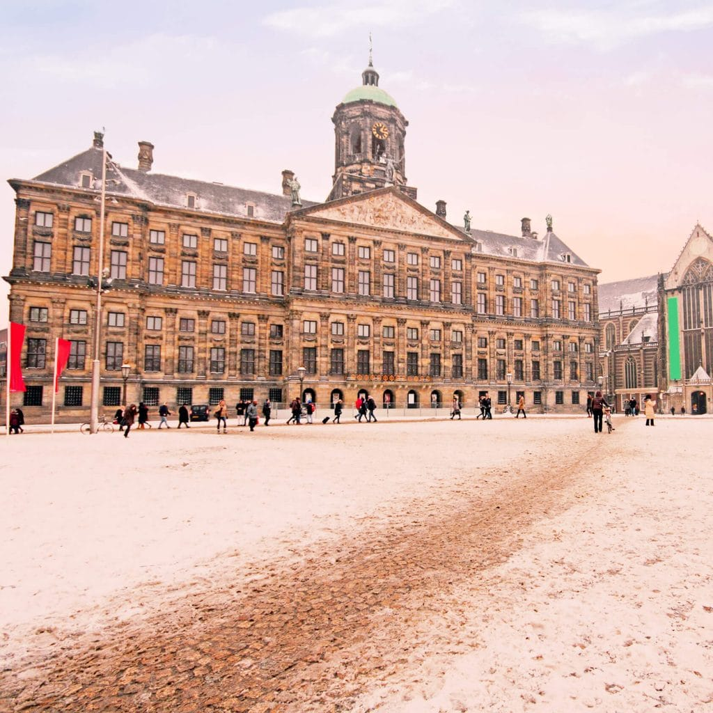 Dam Square covered in snow in winter. #amsterdam #Netherlands