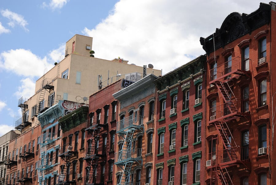 Photo of old tenement buildings on the Lower East Side, a historic part of Manhattan, one of the things that you need to see during your five day trip to New York City. #travel #NYC