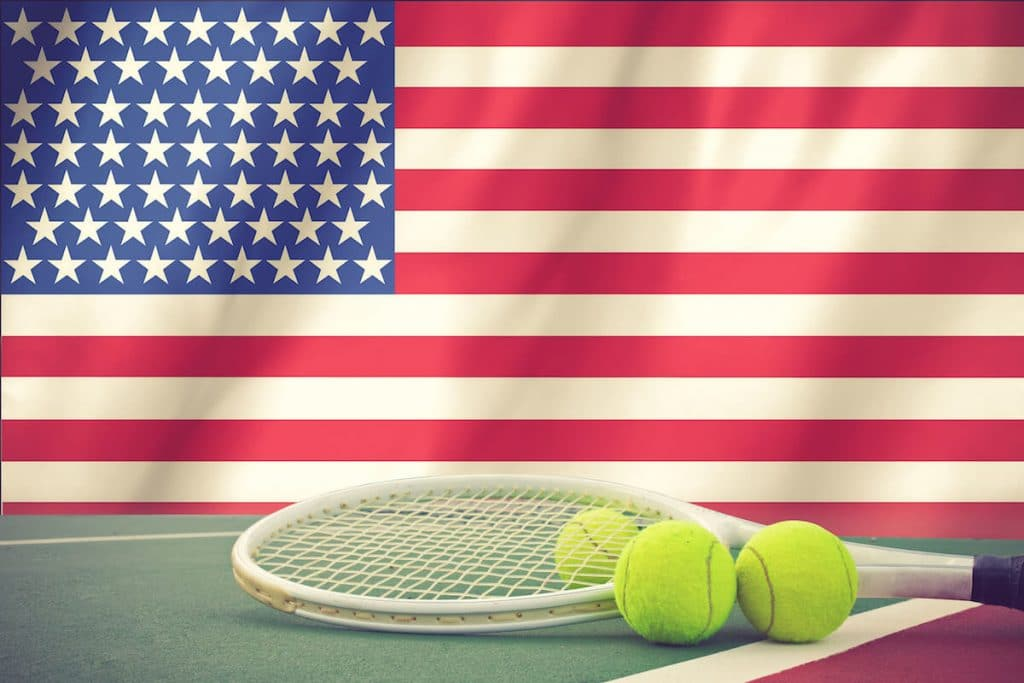 Tennis racquet next to US Flag. Read about the US open for tennis and tips for attending the US Open in New York.