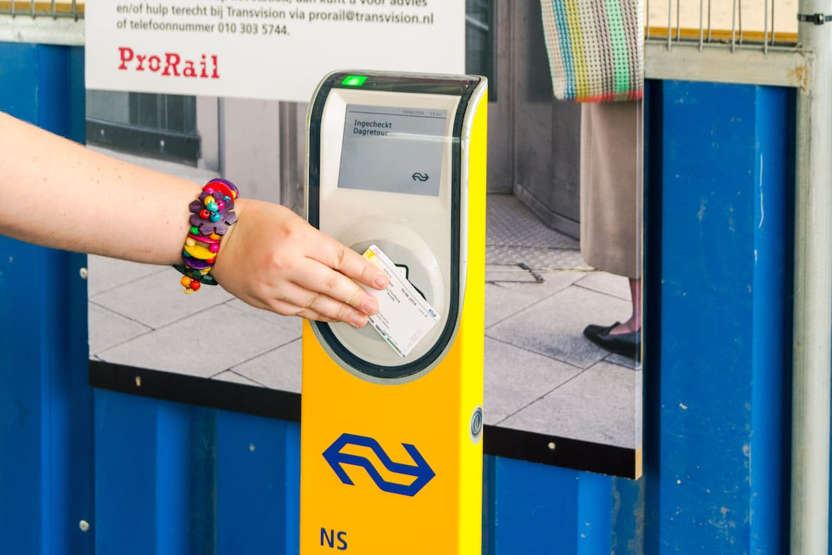 Girl using the Dagkaart, one of the best ways to save money on the Dutch trains and buy discount train tickets in the Netherlands. #dutch #trein #travel