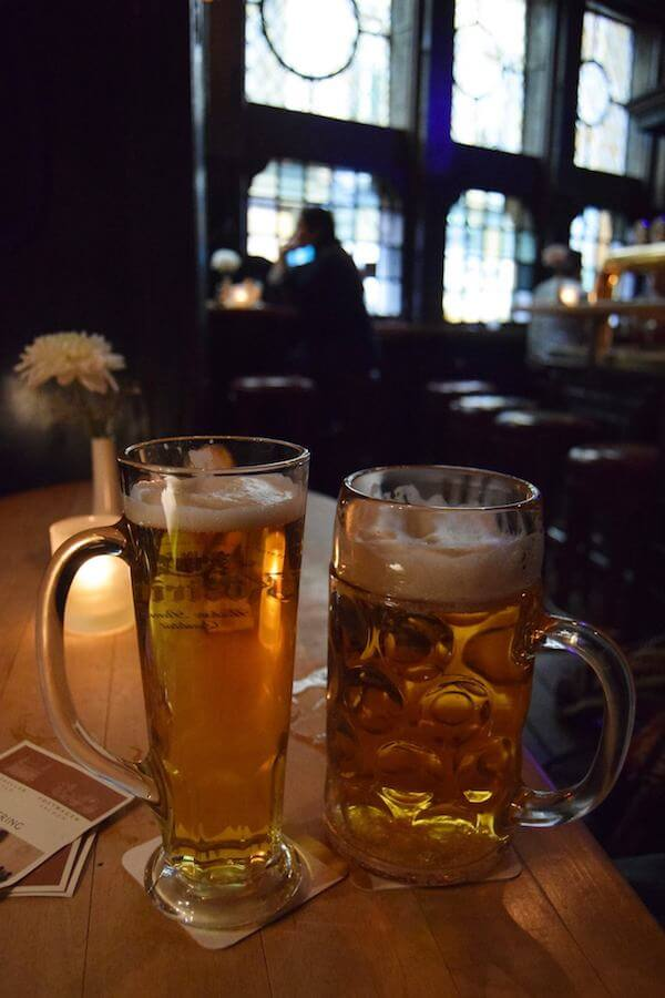 A beer at the historic cafe near the Rathaus in Aachen, Germany. Trying the local beer is a must in Germany! #travel #beer #bier #germany #aachen