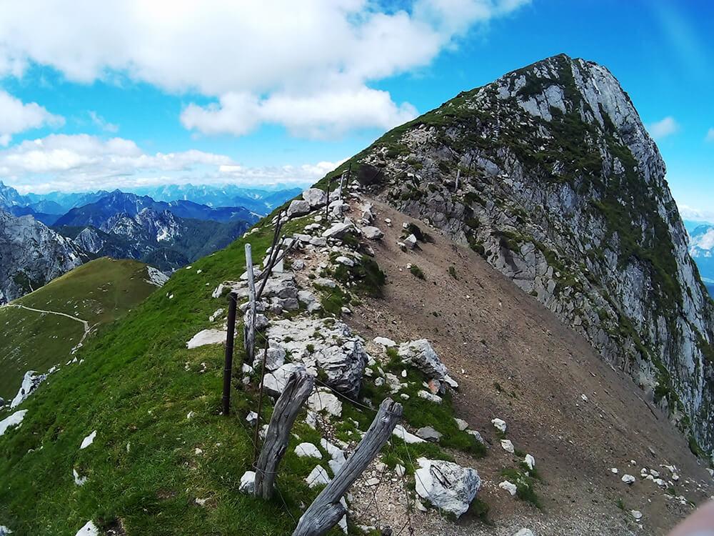 Fence separating the Italian and Slovenia border on Mangart, a beautiful mountain in Slovenia