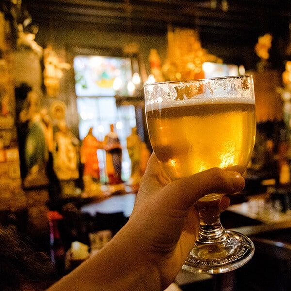 Beer at Het Elfde Gebod, one of the craziest cafes in Antwerp, Belgium. This unique cafe must be on your Antwerp Itinerary! #travel #beer #antwerp