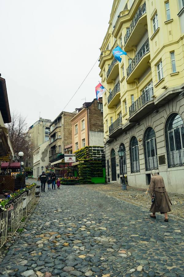 Woman walking up Skadarlija, one of the most famous streets in Belgrade. This neighborhood is a must for first time travelers to Belgrade! #travel #Belgrade #serbia