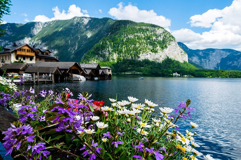 Beautiful view of Hallstatter See from a restaurant in Hallstatt, including boats along wooden docks.