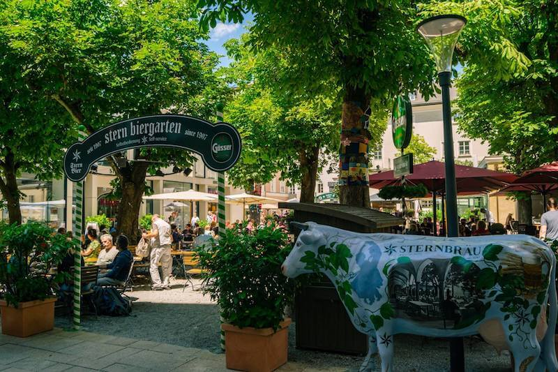 Scenic view of Sternbräu biergarten, a great place to get authentic Austrian food in Salzburg, Austria. Read what to do in one day in Salzburg.