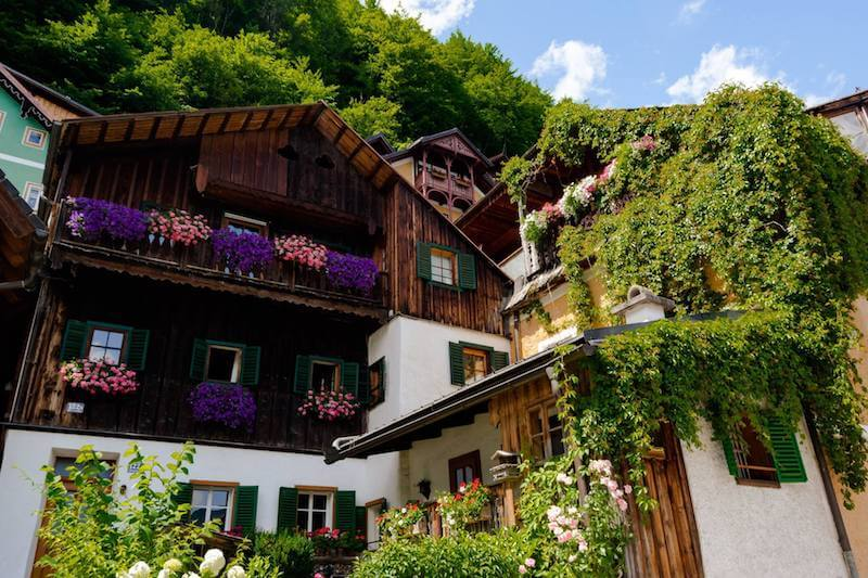 Beautiful timber building in Hallstatt, Austria with a view looking up towards the mountain.