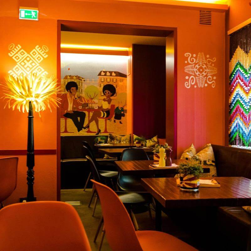 Photo of Afrocafe, a colorful modern coffee house in Salzburg, Austria.