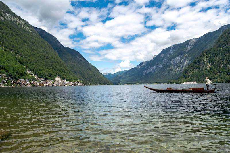 Traditional boat along the Hallstätter See with a view of Hallstatt, Austria.