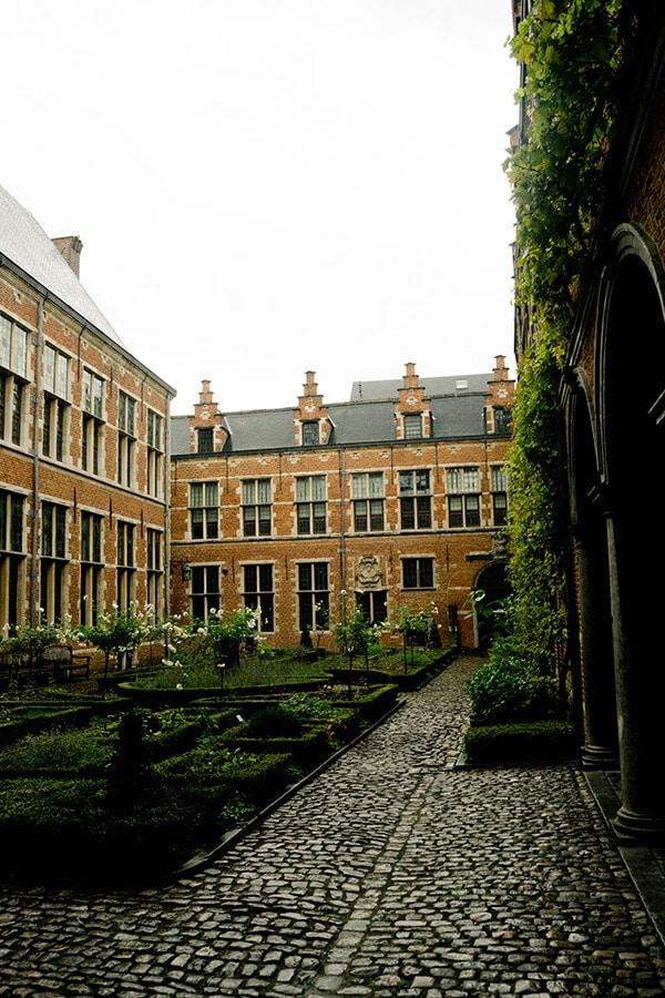 Courtyard of plantin-moretus museum, one of the best museums in Antwerp, Belgium.  This UNESCO recognized attraction in Belgium. #travel #antwerp #belgium