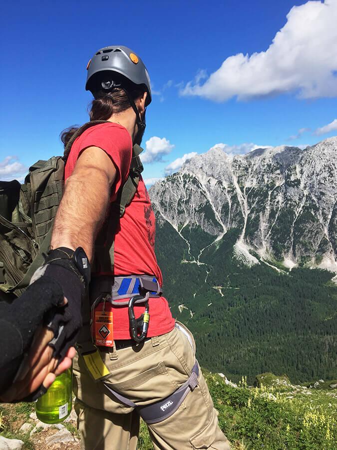 Man working on a klettersteig/via ferrata in Slovenia. Mangart is a challenging via ferrata in Slovenia. #travel #adventuretravel #slovenia