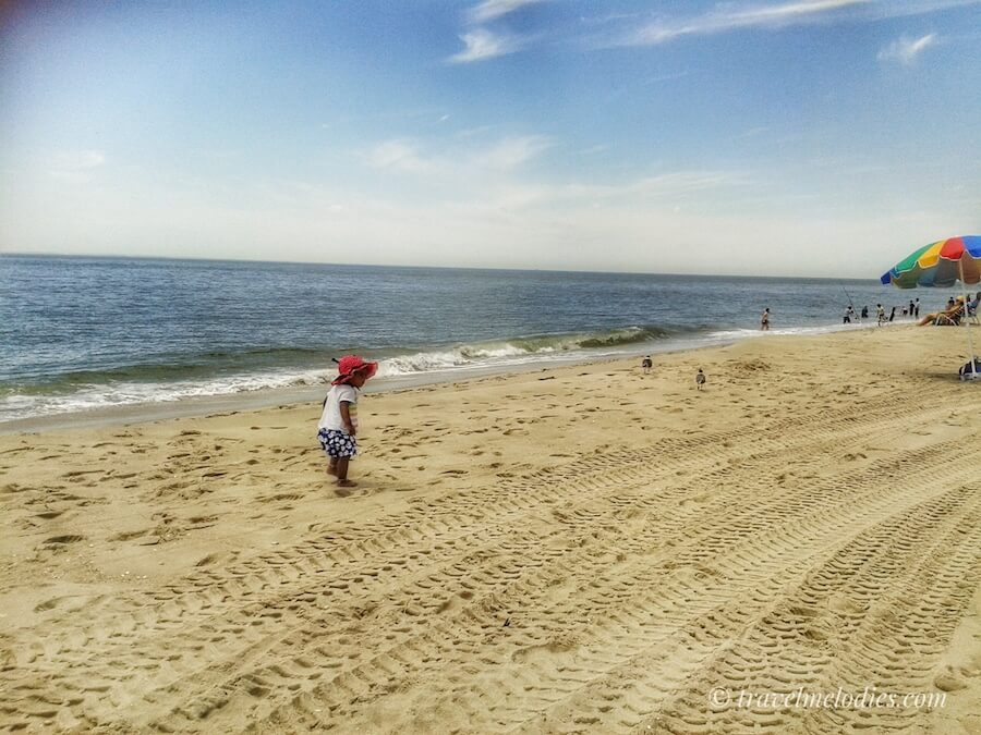 Child enjoying the beach near Atlantic City, one of the best day trips from Philly!