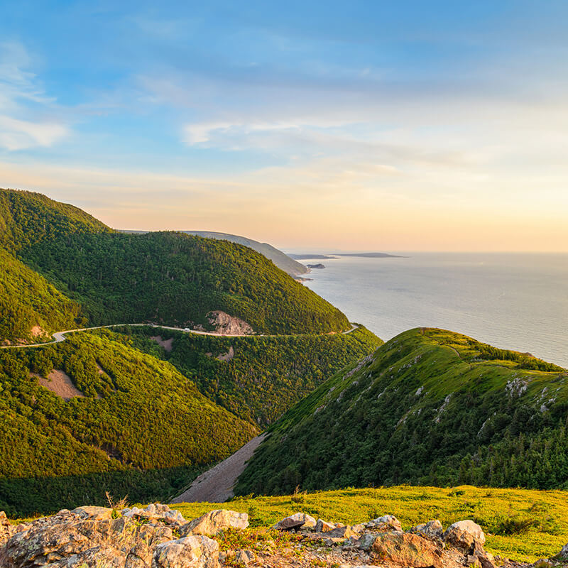 Beautiful landscape of Cape Breton Island at sunset.  This road is one of the best road trips in the world! #travel #canada #capebreton