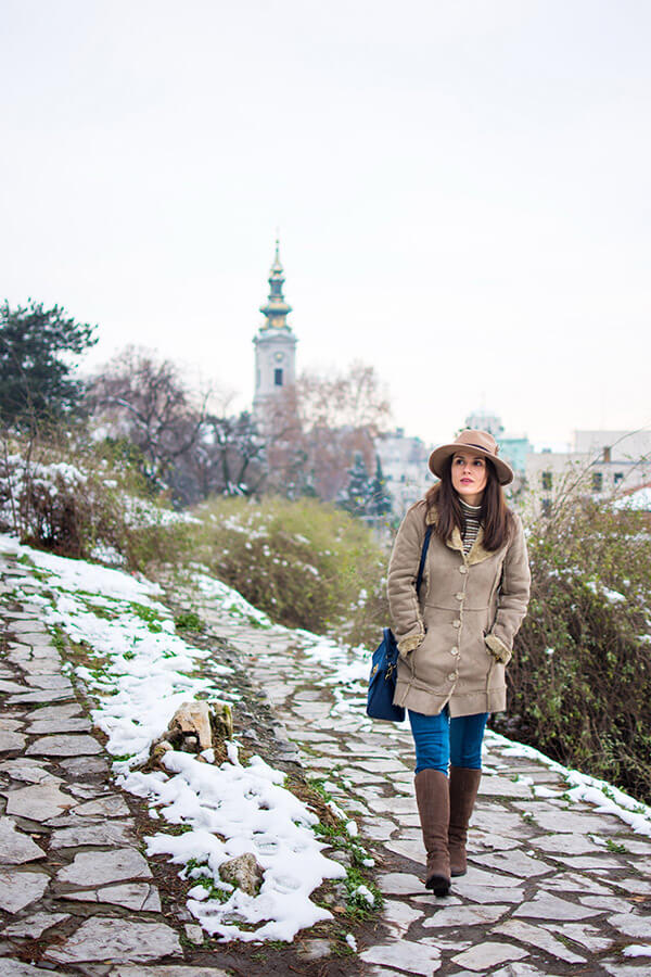 Girl exploring a beautiful snowy hill in Serbia. Looking for a local experience? Read about the new way to meet locals while traveling online!