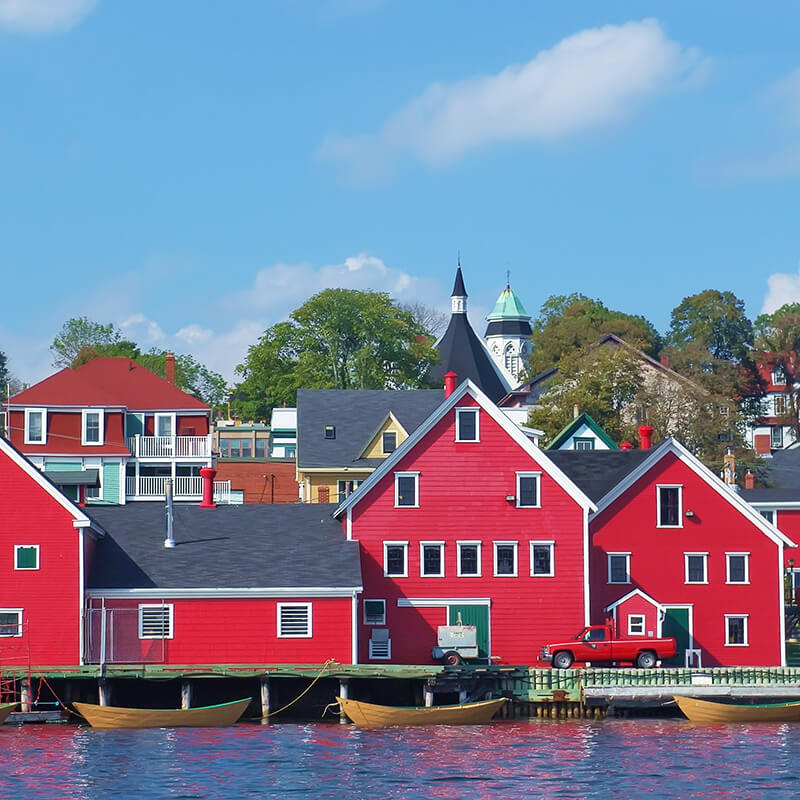 Red houses in the stunning UNESCO recognized Canadian town of Lunenburg in Nova Scotia. #travel