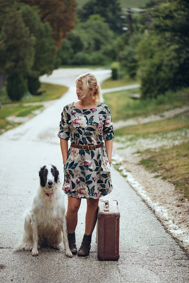Woman traveling with her dog. Traveling with your dog doesn't need to be so complicated! #travel #pets #dogs